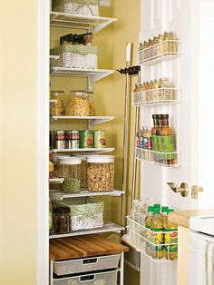 Small Kitchen Pantry - we've got one - love the door spice/sauce wracks!