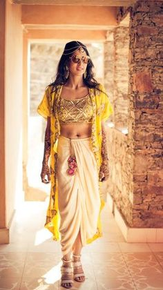 White Dhoti Pants with Yellow Choli and Jacket  To see more such gorgeous mehendi outfits see http://www.functionmania.com/blog/10-gorgeous-mehendi-outfit-styles-modern-bride/