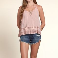 Girls Lace Peasant Tank | Lightweight and drapey with lace panel detailing, a cute cropped length and tassels at neckline | HollisterCo.com