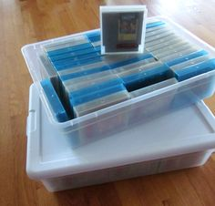 Finally I found a low-height tub that holds a lot of carts in a single row, and isn't too heavy to lug around. It only took me 30 years - success! :)  Read more: http://www.8-bitcentral.com/blog/2015/nesStorageTubs.html#ixzz3rUtaEMWI NES storage tubs