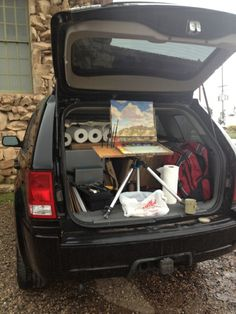 Don't let the weather stop you! Plein air painting in the back of the car.