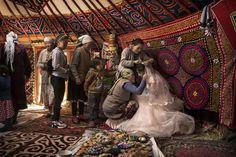 A bride gets dressed at a Kazakh wedding, Altai Mountains, Kazakhstan