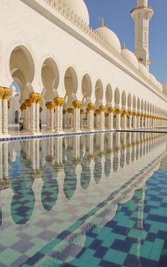 Reflection in the arcade pool of Sheikh Zayed Grand Mosque.  Abu Dhabi, UAE.  Photo by Gail Sparks on flickr.