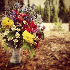 Wild-flower themed bouquet.  This one holds a few flowers from our private cutting garden, including red columbine!  It is illegal to pick wildflowers in Colorado, and only so much is produced commercially.  But, we grow our own, so ask us about that!  http://petalandbean.com