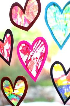 How awesome and fun do these spin art heart suncatchers look for Valentine's Day?!