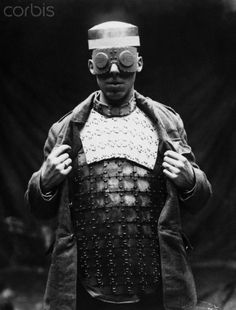 A man models a prototype of armor designed for soldiers to use in battle during World War I. UK.