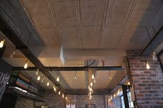 Raw Concrete Grey panels used on the ceiling area