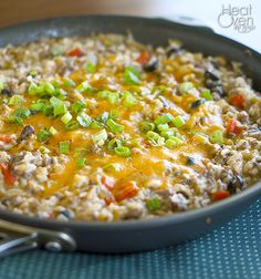 Enchilada Rice: 1 cup uncooked rice 1 pound lean ground beef or ground turkey 1 medium onion, chopped 1 red bell peppers, chopped 1/2 teaspoon chili powder 1/4 teaspoon ground cumin 1/4 cup light sour cream 2 cups green enchilada sauce (about 1 1/2 cans) 1 cup shredded cheddar cheese, divided 1 can sliced black olives 1 cup canned black beans, rinsed 1/2 cup sliced green onions