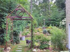 This home-made garden trellis in Julie T's garden in southern Vermont adds interest while welcoming guests to the garden. The wreath is old barbed wire!