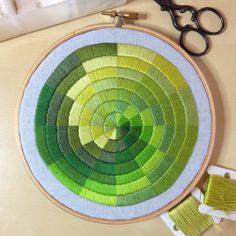 Green satin stitched colourwheel embroidery by Corinne Sleight 2014