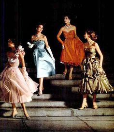 Dance dresses from left to right: pink tulle by Lilly Dache, blue satin with pearls and beads by Anna Miller and worn by Dorian Leigh, red lace by Larry Aldrich, gold gauze pouf by Hattie Carnegie worn by Suzy Parker, photo by Nina Leen, 1951