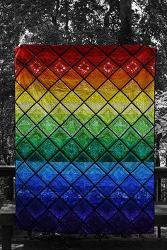 #rainbow #quilts seem so trendy right now. The latticework on this one gives it the feeling of stained glass