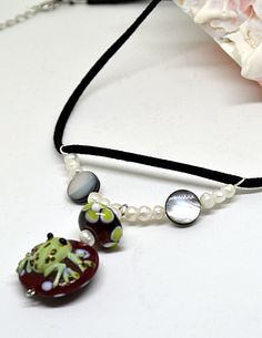 Check out this item in my Etsy shop https://www.etsy.com/listing/503291499/lampwork-bead-frog-necklace-glass-frog