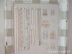 decorative nail heads on fabric-covered cork board would serve more delicate pieces well.