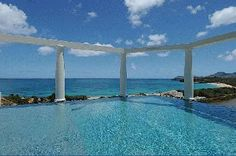"""Waterfront Luxury Villa Vacation Rentals with private pool - St Martin - Terres Basses - Baie Rouge - FWI     French for Love's Nest """"Nid d'Amour"""" is simply superb!   This fully air-conditioned 2 bedroom villa offers Spectacular Views over Baie Rouge which combined with the soft sea breezes transform this villa into the perfect romantic hideaway or simply said the ideal Love's Nest.    http://saint-martin-locations.blogspot.fr/"""