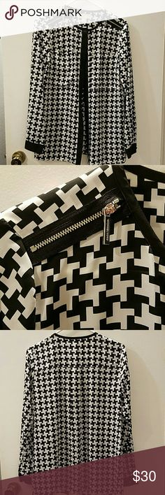 Michael Kors blouse Michael Kors black and white button down houndstooth print long sleeve blouse with 2 front pockets and silver zippers on the shoulders.  This top is in very good condition, only worn once. MICHAEL Michael Kors Tops Button Down Shirts