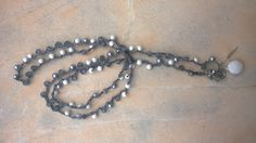 crochet necklace with grey cat's eye beads