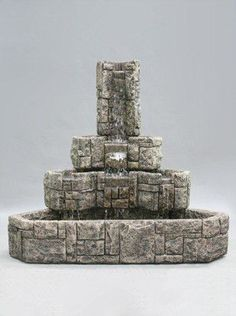 Designed to fill an otherwise empty garden corner, the Corner Courtyard Outdoor Water Fountain features a striking stone design made out of durable cast stone. With water flowing gracefully from tier