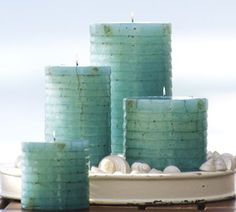 Turquoise candles set a beachy, relaxed mood
