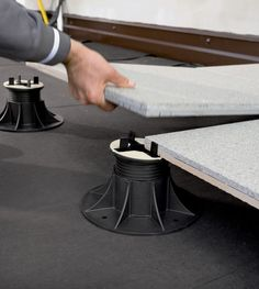 The self levelling heads of the Eterno Ivica pedestals make creating a level raised patio easy.