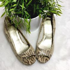 Coke Haan Snake Peep Toe Cork Heel Perfect professional footwear, these Nike Air soles will keep you going all day - miles of style! Perfect condition, NWOT! Cole Haan Shoes