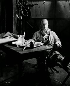 circa 1935:  Still wearing the monster make-up for his role in 'Bride of Frankenstein', directed by James Whale, English actor Boris Karloff sits down for a snack on set.  (Photo via John Kobal Foundation/Getty Images)