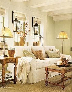 Beautiful & Inviting Living Room - Cottage Chic.an idea for between bay windows for window seat lighting!