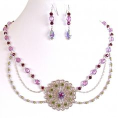 Sugar Plum: 18″ Swarovski Crystal Necklace Set $70.00 This romantic, modern collar draws from Elizabethan style with plentiful crystal and pearls in a luxurious palette. https://earthandmoondesign.com/shop/etherea/sugar-plum-18-inch-swarovski-crystal-necklace-set/