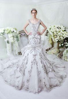Image from http://i00.i.aliimg.com/wsphoto/v0/32276771068_2/Dubai-Saudi-Arabic-Luxury-Heavy-Beads-Wedding-Dresses-2015-New-Crystal-Beads-Wedding-Gowns-Bridal-Gowns.jpg.