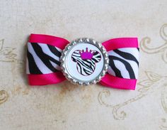 Minnie Mouse hair bow Zebra Disney headband bottle cap bow. $4.50, via Etsy.