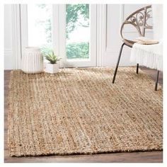 "• 100% sisal construction<br>• No backing<br>• Machine loomed<br>• Low pile; less than .5""<br>• Vacuum regularly; use rug pad<br><br>Give your space a soft update with the Safavieh Natural Fiber Rug. Subtle tones and a woven pattern will give your décor a fresh new look. The low pile is easy on your feet and the durable construction will stand up to heavy foot traffic."