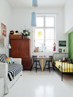 Great splashes of color paired with black & white in this sophisticated / upscale bedroom decorated for a child. #kidsroom