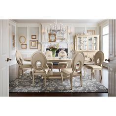 Alluring Tempo. When drama and glamour come together in a design like this, it can only be the Allegro dining room collection. Its platinum color has a chic appearance, while the oval table boasts an extending leaf to accommodate more guests. Chairs feature an elegant champagne-colored upholstery on seats and chair backs. The table's glass inlays lend sparkling sophistication, and a hardwood frame means the Allegro will stand the test of time.  Seven-piece package includes oval dining table…