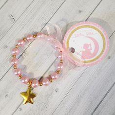 8 - Twinkle Twinkle Little Star Party Favor Bracelet Twinkle Twinkle First Birthday Baby Shower Favor Pink & Gold Party Favors by MichelleAndCompany on Etsy https://www.etsy.com/listing/266288216/8-twinkle-twinkle-little-star-party