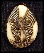 'Zebra Grazing' - Pyrography (woodburning)  and acrylic paint on a Tagua slice.  (Palm Ivory) - Sue Walters