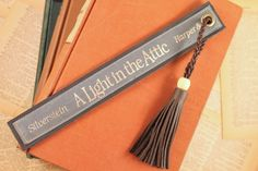 Leather Bookmark - A Light In The Attic- Shel Silverstein - Book Spine Bookmark - Leather Tassel - Poetry Bookmark - Unique Bookmark by TheGildedLion on Etsy https://www.etsy.com/listing/244087814/leather-bookmark-a-light-in-the-attic