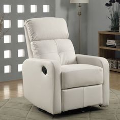 This stylish recliner features a contemporary design and white bonded leather upholstery. This chair swivels on its base and reclines for comfort.