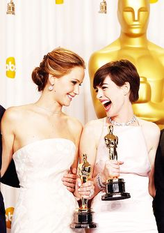 "Jennifer Lawrence and Anne Hathaway. I just think its funny how Anne is laughing the ""rich person/movie star"" laugh and Jen is just like haha normal person laughing."