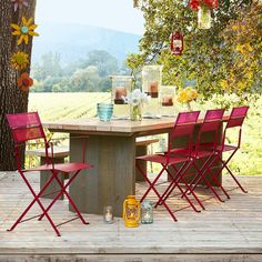 """STEWART FALLS OUTDOOR DINING TABLE--Adapted for outdoor use, our handsome, substantial outdoor reclaimed wood table is handcrafted of vintage pine floor joists, salvaged from barns throughout the Midwest. USA. Catalog exclusive. 36""""D x 30""""H."""