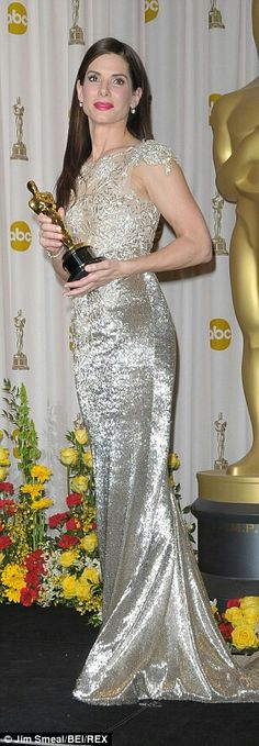 In 2010, Sandra Bullock glittered in shimmering silver and lace Marchesa column gown