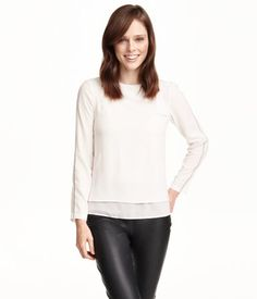 Long-sleeved blouse in woven crêpe fabric. Wrapover back section with buttons at top and an airy chiffon lining.