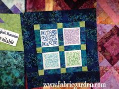 Our QR Code Quilt!  We printed our codes (Facebook, Twitter, web, VCard) on printable fabric sheets.