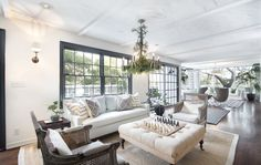 The expansive living room includes two sitting areas.