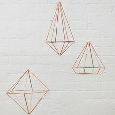 Set of 3 copper plated metal geometric shapes. Whether hung from the ceiling, wall mounted or positioned on a table surface, these geometric shapes add instant update to any room.