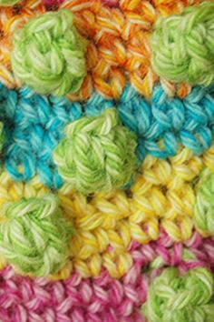 No explanation or pattern....but I like the idea of random bobbles in a different color....could be figured out
