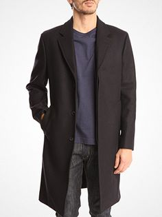 Unconstructed navy coat by Our Legacy. On sale.