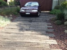 Railway sleepers and scoria make a great driveway outside an architecturally designed house