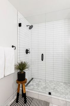Before & After: A Fresh Start In San Diego – Homepolish Homepolish designer Caity Hall used handmade elongated white subway tiles in a linear pattern with dark grout in this bathroom for a blend of contemporary and classic styles. Bathroom Layout, Small Bathroom, Master Bathroom, Bathroom Ideas, Bathroom Organization, Neutral Bathroom, Shower Ideas, Bathroom Artwork, Condo Bathroom