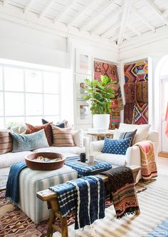 The different patterns of the blankets and pillows make the space feel more…