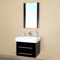 This modern bathroom vanity features an exquisite, contemporary design. This vanity includes a ceramic counter-top, a semi-closing waterproof wood finish, two drawers and a nickel finish and the hardware.